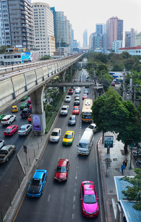BANGKOK, THAILAND - MARCH 11, 2015. Traffic on the street around Moh Chit BTS station on March 11, 2015. Mo Chit Station is a BTS skytrain station in Chatuchak District, Bangkok, Thailand.