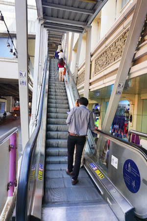 BANGKOK, THAILAND - JAN 4, 2015: Unidentified rail travellers pass through a BTS Skytrain station during rush hour in Bangkok, Thailand. Launched in 1999, the BTS now has a daily ridership of 600,000.