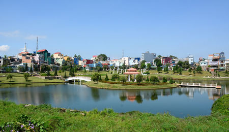 loc: BAO LỌC, VIETNAM - APR 1, 2015: View of Bao Loc lake and tree park in Bao Loc city. Bao Loc is a mid-sized city that looks like a cross between Vietnam and the French Alps in high mountain.
