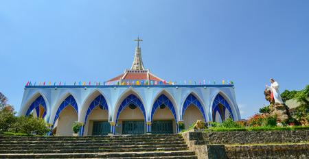 loc: BAO LOC, VIETNAM - MAR 26, 2015: Old beautiful church on summers day in Bao Loc, Vietnam. Bao Loc is city of Lam Dong highland province in Vietnam. Stock Photo
