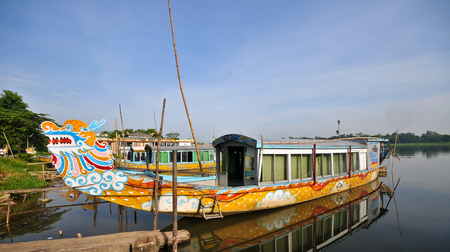 Tourist boats, dragon shaped in Hue, the ancient capital of Vietnam.