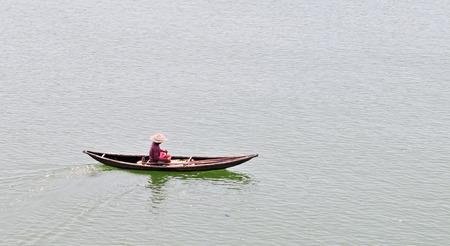 freshwater sailor: Isolate boat floating on the Mekong river, Vietnam.