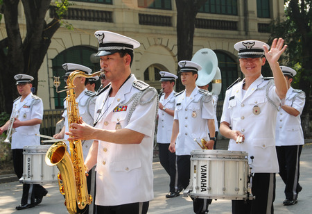 constabulary: HANOI, VIETNAM - SEP 2, 2014. Independence Day celebrations in the capital of Vietnam. A police brass orchestra on Hoan Kiem park in Hanoi, Vietnam. Editorial