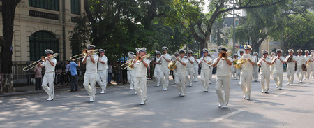 HANOI, VIETNAM - SEP 2, 2014. Independence Day celebrations in the capital of Vietnam. A police brass orchestra on Hoan Kiem park in Hanoi, Vietnam. Editorial
