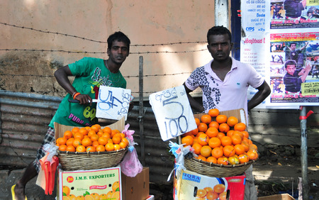 GALLE, SRI LANKA - APR 17, 2015. Vendor selling fresh vegetables and fruits in Galle, Sri Lanka. Many people buy fresh food on the street rather than at shops. Editorial