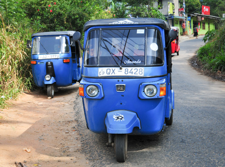 auto rickshaw: DAMBULLA, SRI LANKA - JANUARY 27, 2014. Auto rickshaw or tuk-tuk on the street of Dambulla. Most tuk-tuks in Sri Lanka are a slightly modified Indian Bajaj model, imported from India.