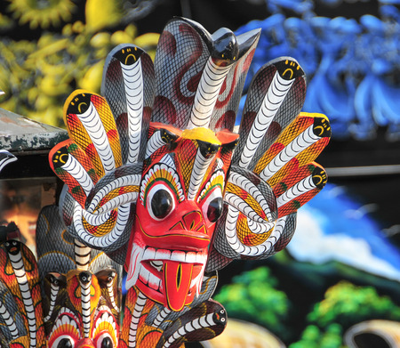 Sri Lankan traditional Fire Devil masks to sell at a store near the road.