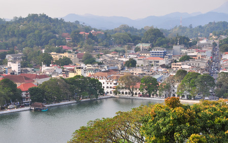 places of worship: View on Kandy lake and city buildings. Kandy is home of The Temple of the Tooth Relic, one of the most sacred Buddhist places of worship.