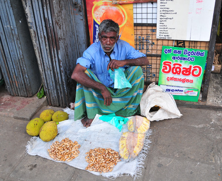 HIKKADUWA, SRI LANKA - FEBRUARY 23, 2015. Portrait of elderly market vendor selling his produce. The Sunday market is great way to see Hikkaduwas local life.