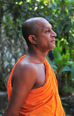 unambiguous: DAMBULLA, SRI LANKA - APR 11, 2015: Buddhist monk at a monastery in Dambulla, Sri Lanka. Sri Lnaka has unambiguous Buddhist majorities in the county. Editorial