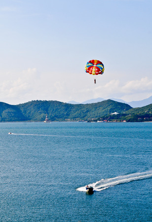 tourist destinations: Parasailing in the Bay of Nha Trang. It is one of the most popular fishing, sailing and tourist destinations in southern Vietnam.