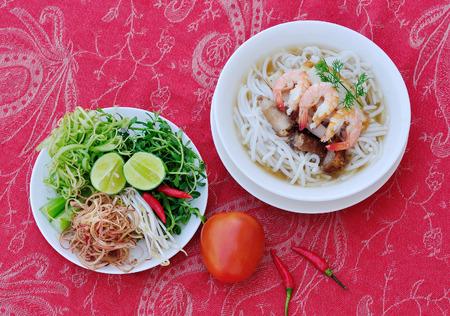 mam: Bun mam - Vietnamese vermicelli soup, fried pork, fish sauce, shrimp, squid, noodle and vegetables. Stock Photo