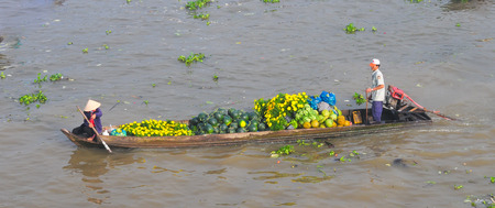 can tho: Asian hawker rowing the stall boat at floating market Mekong River, Cai Rang, Can Tho, Vietnam. Editorial