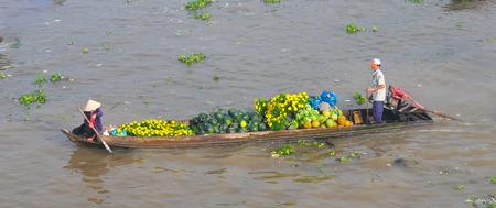 cai rang: Asian hawker rowing the stall boat at floating market Mekong River, Cai Rang, Can Tho, Vietnam. Editorial