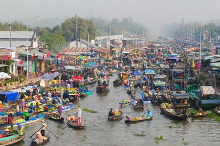 rang: Nga Nam floating market in sunrise in Soc Trang, Vietnam. Nga Nam market is the convergent point of five rivers which flow into five different directions. Editorial