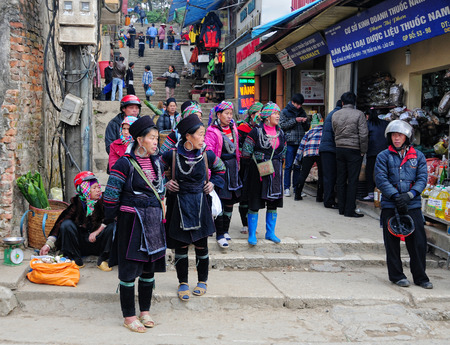 Hmong women in a traditional costume work on a market. Hmong people is a minority ethnic group living in Sapa.