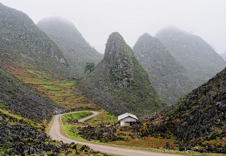 unsurfaced road: Mountain road in beautiful valley, Ha Giang province, Vietnam.