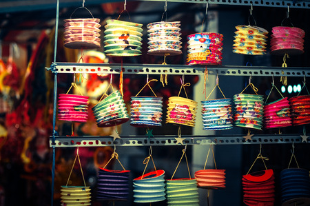 Colorful lanterns hanging at the shop for Mid-Autumn festival in Cho Lon market, Saigon, Vietnam. Stock Photo