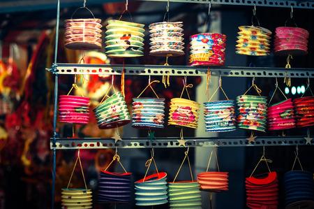 Colorful lanterns hanging at the shop for Mid-Autumn festival in Cho Lon market, Saigon, Vietnam. Banque d'images