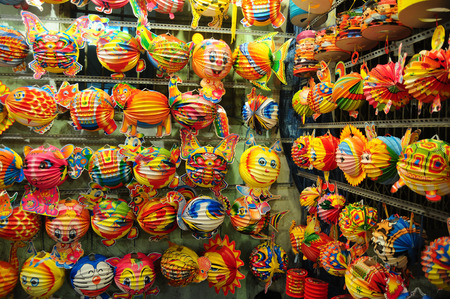 lon: Colorful lanterns hanging at the shop for Mid-Autumn festival in Cho Lon market, Saigon, Vietnam. Stock Photo