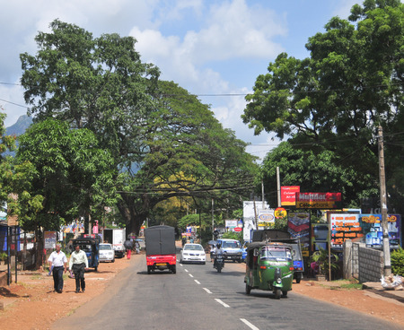 motorcycle police officer: KANDY, SRI LANKA - MARCH 25, 2015. View of Kandy street, Sri Lanka. Kandy is famous because of its Tooth Relic Temple where Buddhas tooth is being kept. Editorial