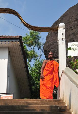 DAMBULLA, SRI LANKA - APR 11, 2015: Buddhist monk at a monastery in Dambulla, Sri Lanka. Sri Lnaka has unambiguous Buddhist majorities in the county. Editorial