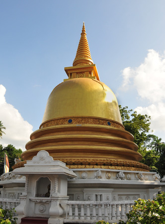 medeival: Golden stupa at the entrance to the Dambulla Cave Temples on the island of Sri Lanka.