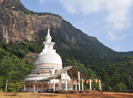 adams: White stupa under Adams Peak in Sri Lanka.