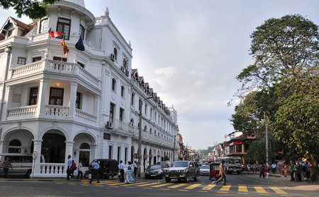 motorcycle police officer: KANDY, SRI LANKA - MARCH 25, 2015. People and vehicles on Kandy street, Sri Lanka. Kandy is famous because of its Tooth Relic Temple where Buddhas tooth is being kept.
