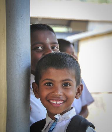 sigiriya: SIGIRIYA, SRI LANKA - FEBRUARY 28, 2015. Group of unidentified school students posing in train station after studying. Sigiriya is UNESCO listed World Heritage Site.