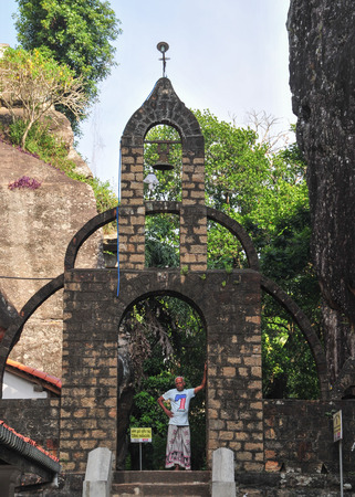 unambiguous: DAMBULLA, SRI LANKA - APR 11, 2015. A man at a monastery in Dambulla, Sri Lanka. Sri Lnaka has unambiguous Buddhist majorities in the county.