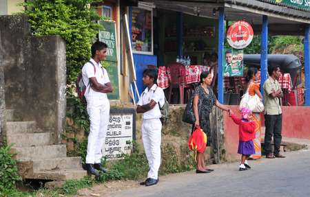 motorcycle police officer: KANDY, SRI LANKA - MARCH 25, 2015. People on Kandy street, Sri Lanka. Kandy is famous because of its Tooth Relic Temple where Buddhas tooth is being kept.
