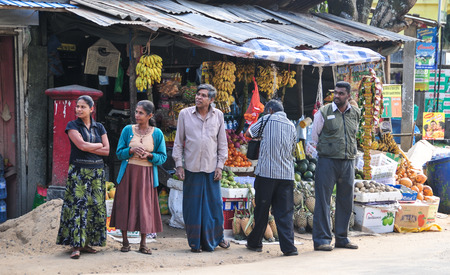 widespread: BENTOTA, SRI LANKA - JAN 31, 2012. Sellers in street shop sell fresh fruits and vegetables in Bentota, Sri Lanka. Street shops are widespread retail count in Sri Lanka. Editorial