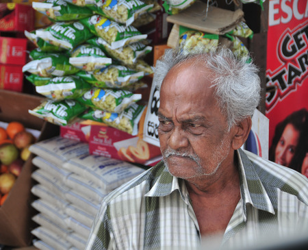 sallad: HIKKADUWA, SRI LANKA - FEBRUARY 1, 2012. Portrait of market vendor selling his produce. The Sunday market is great way to see Hikkaduwas local life.