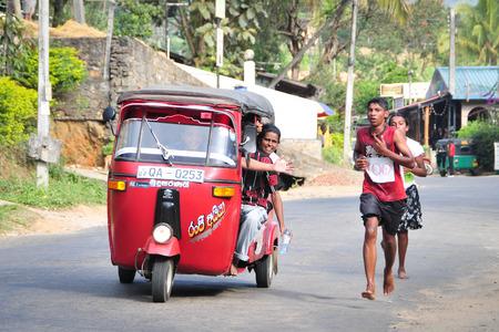 participate: Ella, Sri Lanka - Jan 31, 2012. Students participate in the local marathon in Ella town, Sri Lanka.