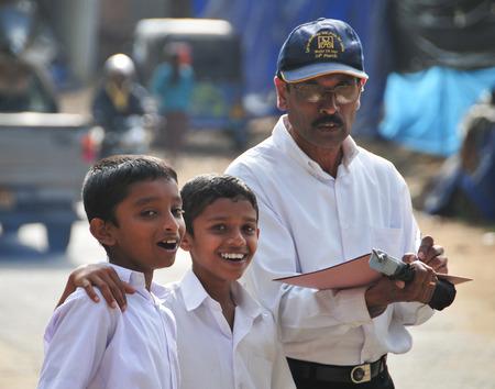 sigiriya: SIGIRIYA, SRI LANKA - JAN 31, 2012. Group of unidentified school students posing on street after studying. Sigiriya is UNESCO listed World Heritage Site.