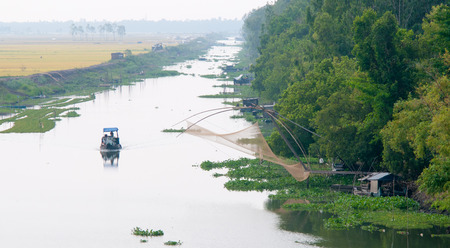 Cargo boat floating on the Mekong river, southern Vietnam. Stock Photo