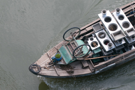 freshwater sailor: Cargo boat floating on the Mekong river, southern Vietnam. Stock Photo