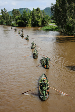 inundated: An Giang Vietnam  Sep 13 2009. Vietnamese soldiers rowing boats on the canal in Mekong Delta southern Vietnam.