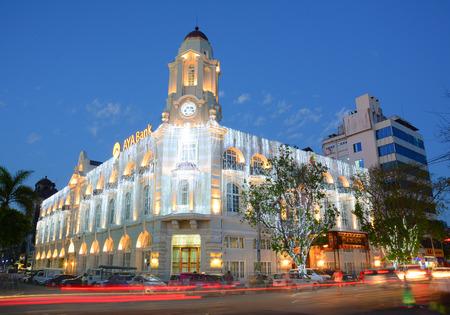 fascinate: YANGON, MYANMAR - JAN 25, 2015. Facade of AYA Bank building at night in Yangon, Myanmar. AYA Bank is a private bank in Myanmar. Editorial