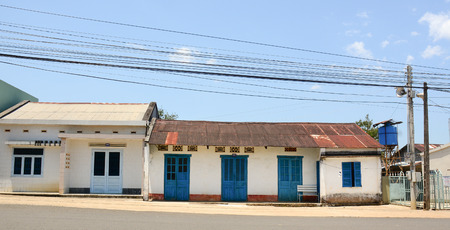 loc: Dalat, Vietnam - Jan 21, 2015. Old houses with blue doors on the hill in Dalat highland, southern Vietnam.