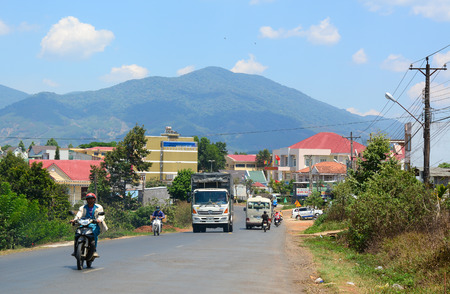 loc: Dalat, Vietnam - Jan 21, 2015. Mountain road at sunny day with clouds on the sky in Dalat highland, Vietnam.
