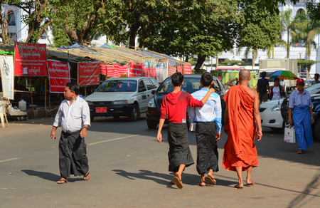typically british: YANGON, MYANMAR - JANUARY 15, 2015. Unidentified people walk in the street in Yangon, Myanmar. Yangon is the largest city and the most important commercial centre in Myanmar.