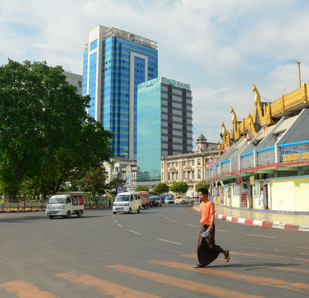 typically english: YANGON, MYANMAR - JANUARY 15, 2015. Unidentified people walk in the street in Yangon, Myanmar. Yangon is the largest city and the most important commercial centre in Myanmar.
