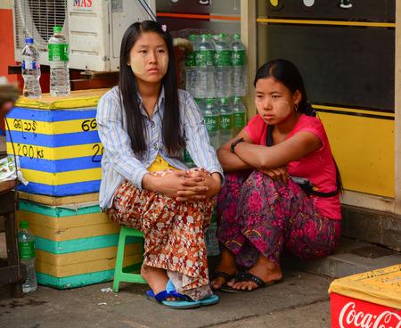 thanaka: YANGON, MYANMAR - JAN 15, 2015. Burmese women with thanaka on her face in Yangon, Myanmar. Thanaka is a yellowish-white cosmetic paste made from ground bark. Editorial