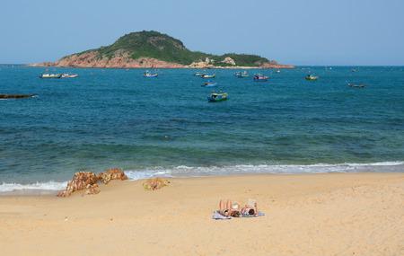 trang: Nha Trang, Vietnam - Apr 20, 2015. Tourists enjoying on tropical beach at Nha Trang, Vietnam. Nha Trang is a popular destination for international tourists. Editorial