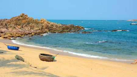 well known: Tropical beach at Nha Trang, Vietnam. Nha Trang is well known for its beaches and has developed into a popular destination for international tourists.