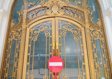 ornate door: Golden ornate door with forbidden sign in Saigon, Vietnam. Editorial