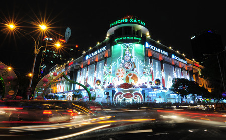 digitals: HO CHI MINH CITY, VIETNAM - DEC 17, 2013. Saigon Tax Trade Center by night in Ho Chi Minh City. Tax Center is the market where you can buy digitals. Editorial