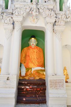 travelled: Buddha statue in Burma famous sacred place and tourist attraction landmark Shwedagon Paya pagoda in Yangon Myanmar. Editorial